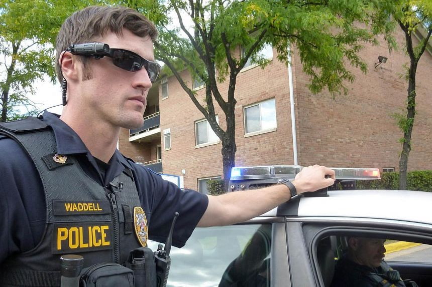 Police Officer Aaron Waddell showing on Sept 17, 2014, how the police department in Laurel, Maryland, has been using body-cameras during patrols for nearly two years. -- PHOTO: AFP