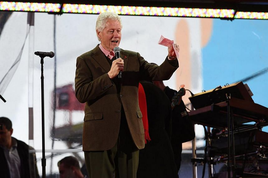 Former US president Bill Clinton addresses the World AIDS Day (RED) concert in Times Square in New York on Dec 1, 2014. -- PHOTO: AFP