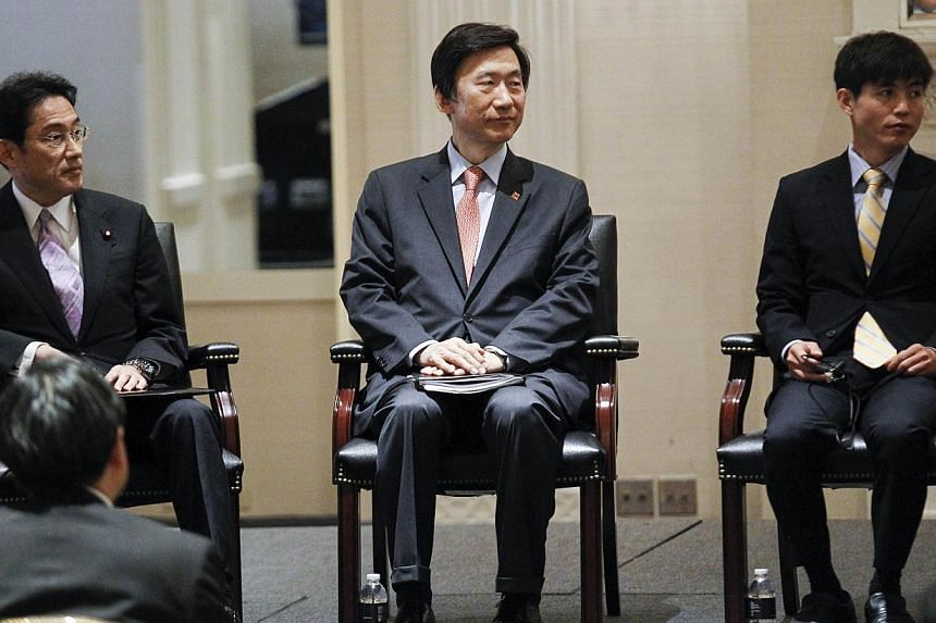South Korean Foreign Minister Yun Byung Se (centre), Japanese Foreign Minister Fumio Kishida (left) and North Korean defector Shin Dong Hyuk attend an event on human rights in the Democratic People's Republic of Korea on Sept 23, 2014 at the Waldorf