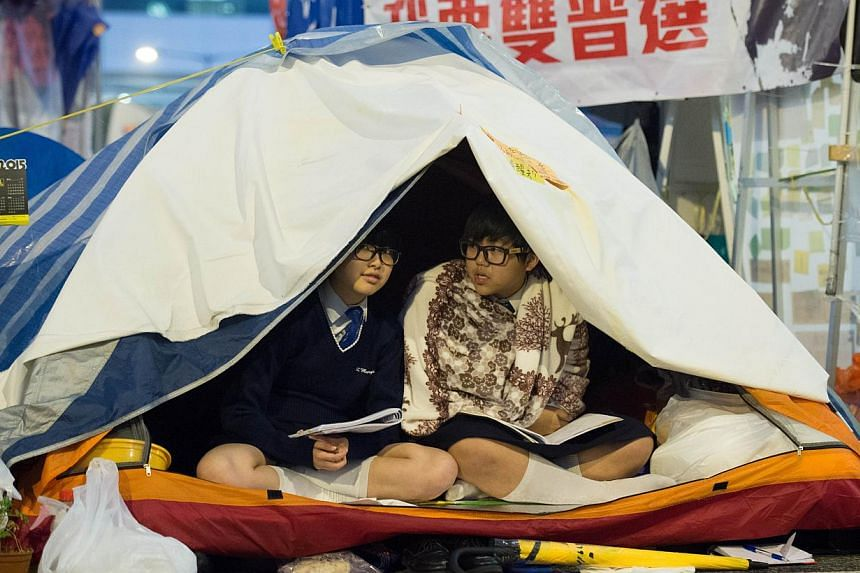 Students in their tents at the pro-democracy movement's main protest site in the Admiralty district of Hong Kong on Dec 2, 2014. -- PHOTO: AFP
