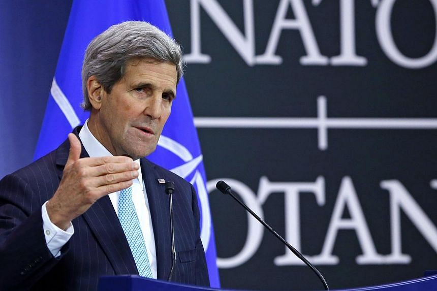 US Secretary of State John Kerry holds a news conference during a NATO foreign ministers meeting at the alliance's headquarters in Brussels. -- PHOTO: REUTERS