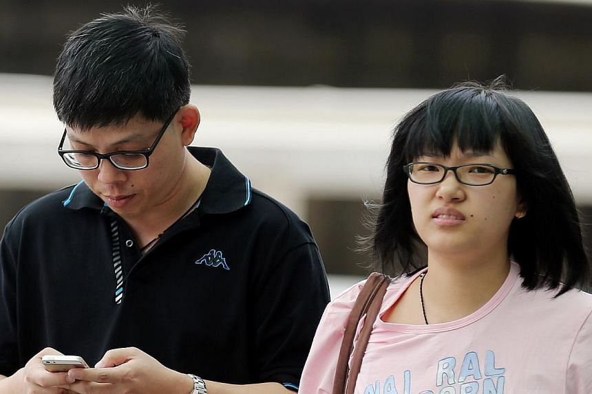 Ong Tiong San (left), 43, was fined $10,000 after pleading guilty to two counts of forgery. He created fake marriage and birth certificates to fool his lover, Ms Zhao Dan (right), a Chinese national.  -- ST PHOTO: WONG KWAI CHOW