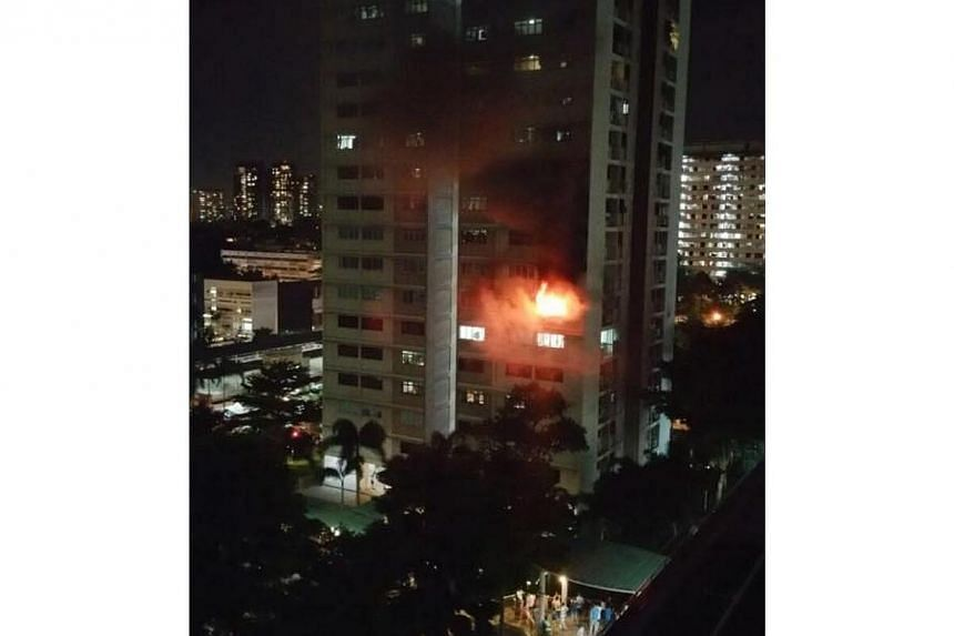 A fire broke out in a flat at Block 8, Ghim Moh roadon Wednesday night. -- PHOTO: ERIC LI