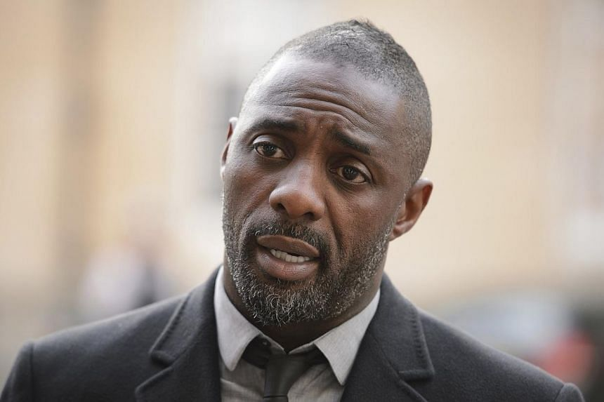 """British actor Idris Elba speaks to the media ahead of the """"Defeating Ebola: Sierra Leone"""" conference in central London, on Oct 2, 2014.British actor Idris Elba and a host of international football stars launched a public awareness campaign on W"""