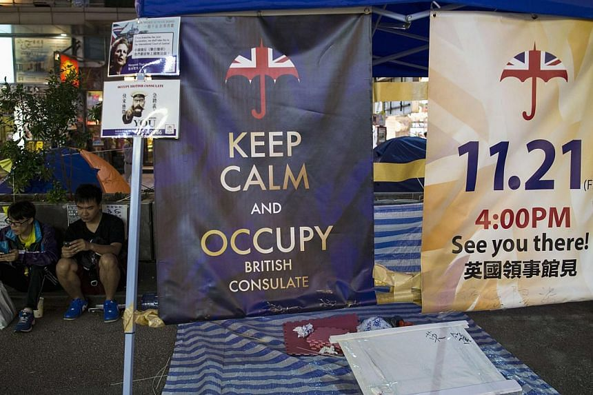 Posters appealing for people to join them for an upcoming protest, are displayed in an area protesters are occupying in Mongkok shopping district in Hong Kong on Nov 10, 2014.China said on Wednesday Britain has had no moral responsibility for w