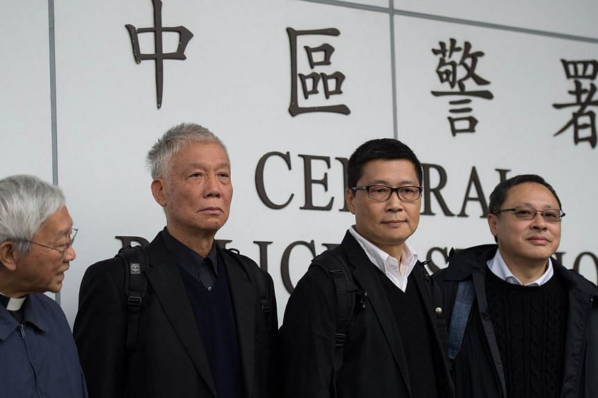 Benny Tai (right), an original founder of the pro-democracy Occupy movement, with (from left) Chinese Cardinal of the Catholic Church and former bishop of Hong Kong, Joseph Zen, and Occupy Central co-leaders Chu Yiu-ming and Chan Kin-man surren