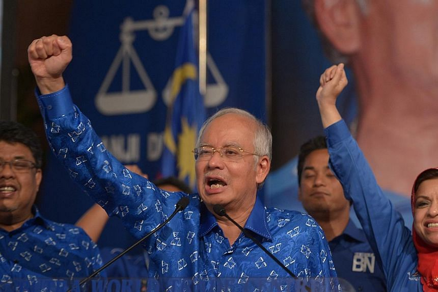 Malaysian Prime Minister Najib Razak (centre) addressing supporters at the Putra World Trade Centre after the Barisan Nasional was declared the winning coalitian of Malaysia's 13th general election. An official Malaysian inquiry on Wednesday c