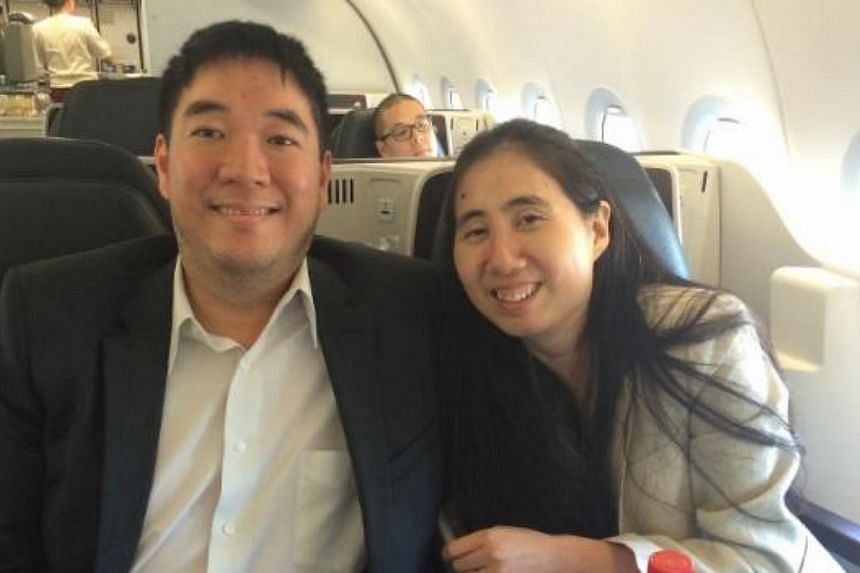 US couple Matthew (left) and Grace Huang leaving Doha. The pair have been cleared of wrongdoing in their adopted daughter's death. -- PHOTO: ERIC VOLZ/ TWITTER