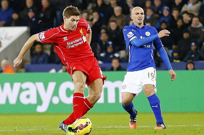 Liverpool's Steven Gerrard (left) shoots to score a goal during their English Premier League match against Leicester City at the King Power Stadium in Leicester on Dec 2, 2014. -- PHOTO: REUTERS