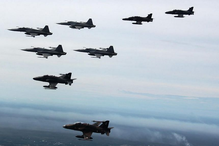 The RSAF's F-5S/T fighter aircraft flying alongside fighter jets from the TNI-AU at Exercise Elang Indopura 2014.-- PHOTO: MINDEF