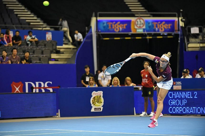 Belgium's Kirsten Flipkens of the Manila Mavericks plays against France's Kristina Mladenovic of the UAE Royals during their women's singles at the International Premier Tennis League (IPTL) competition in Singapore on Dec 3, 2014. The Musafir.c