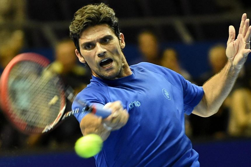 Australia's Mark Philippoussis of the Manila Mavericks plays against Croatia's Goran Ivanisevic of the UAE Royals during their men's singles at the International Premier Tennis League (IPTL) competition in Singapore on Dec 3, 2014.-- PHOTO: AFP