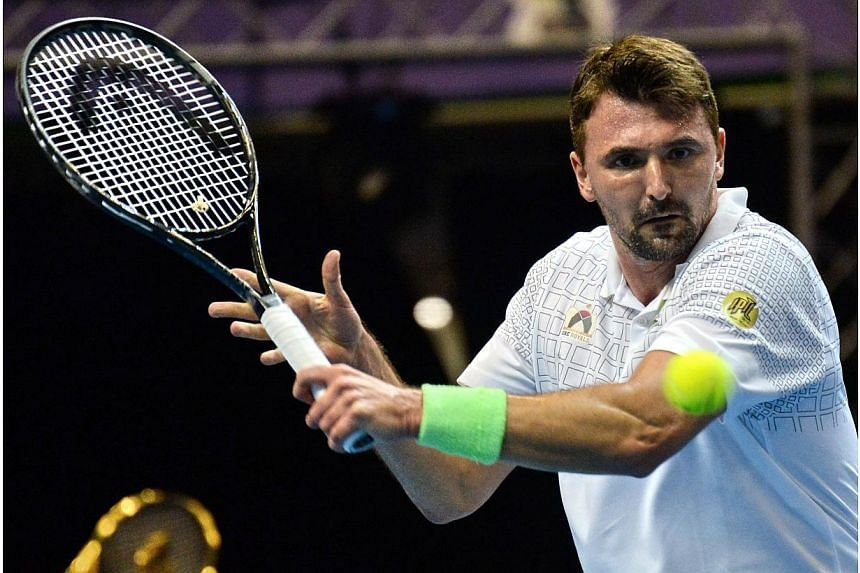 Croatia's Goran Ivanisevic of the UAE Royals play against Australia's Mark Philippoussis of the Manila Mavericks during their men's singles at the International Premier Tennis League (IPTL) competition in Singapore on Dec 3, 2014. -- PHOTO: AFP