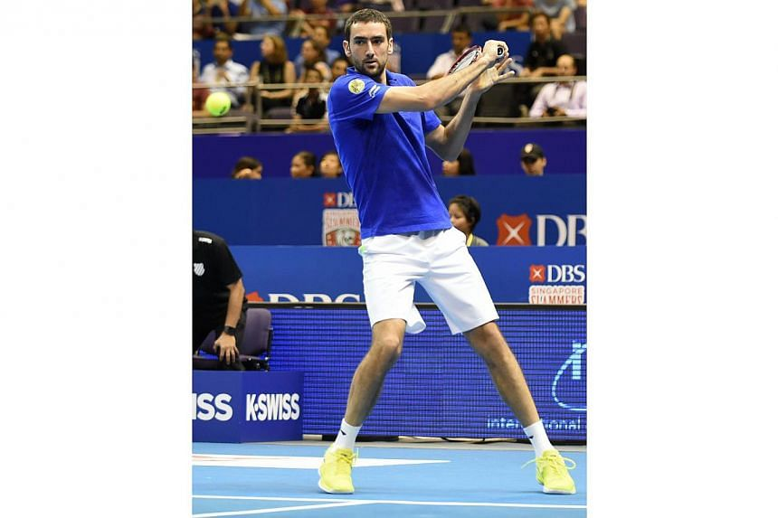 Croatia's Marin Cilic of the UAE Royals plays against France's Jo-Wilfreid Tsonga of the Manila Mavericks during their men's singles at the International Premier Tennis League (IPTL) competition in Singapore on Dec 3, 2014. -- PHOTO: AFP