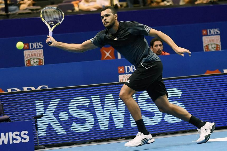 France's Jo-Wilfreid Tsonga of the Manila Mavericks plays against Croatia's Marin Cilic of the UAE Royals during their men's singles at the International Premier Tennis League (IPTL) competition in Singapore on Dec 3, 2014.-- PHOTO: AFP