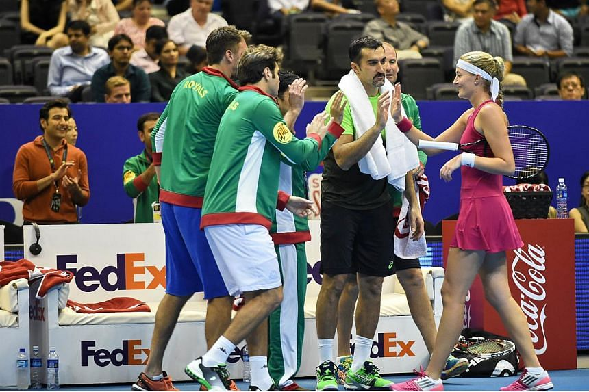 France's Kristina Mladenovic (right) of the UAE Royals greets team mates in between match against Belgium's Kirsten Flipkens of the Manila Mavericks during their women's singles at the International Premier Tennis League (IPTL) competition in Singapo