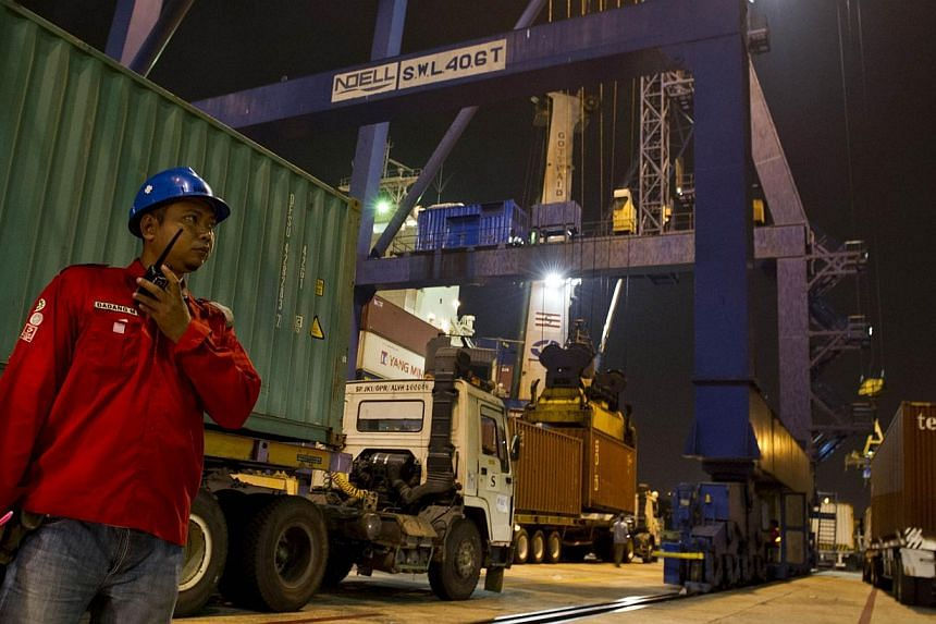 Containers being loaded onto a ship at the Tanjung Priok port district in Jakarta. For Indonesia, the Philippines and Vietnam, investing in infrastructure will be critical to maintaining an edge in the future. Meanwhile, competitiveness in Myanmar, L