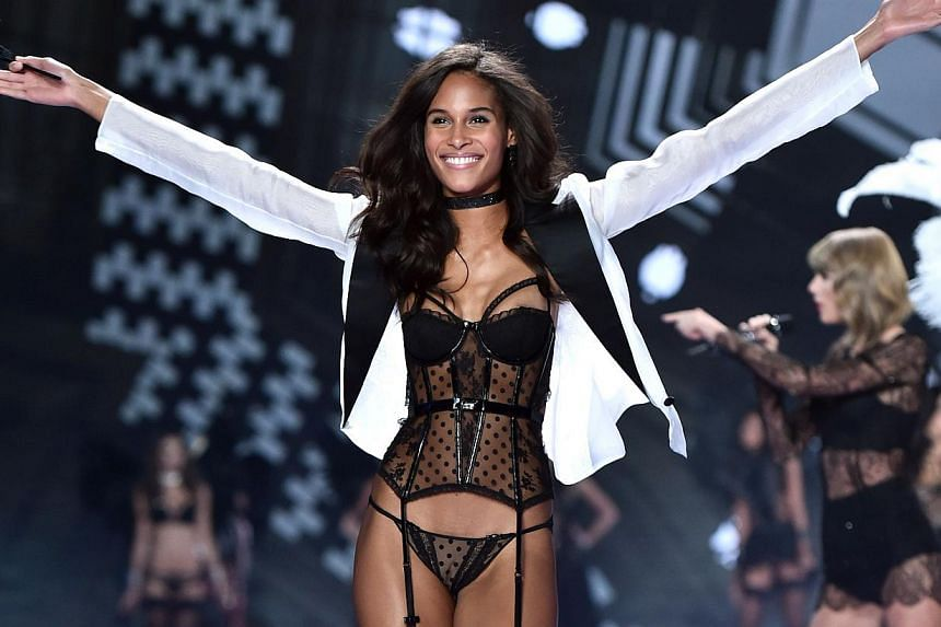 French model Cindy Bruna walking down the runway during the 2014 Victoria's Secret Fashion Show at Earl's Court exhibition centre in London on Dec 2, 2014. -- PHOTO: AFP