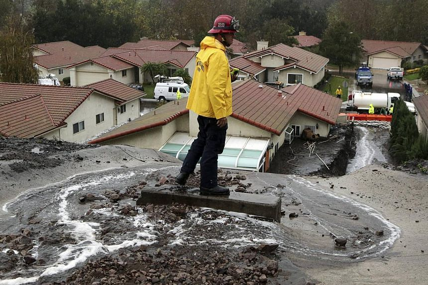A firefighter monitors mudflows in Camarillo, California, on Dec 2, 2014. Torrential rain deluged swathes of drought-hit California on Tuesday, bringing floods and traffic accidents across the state and prompting evacuations amid fears of destructive