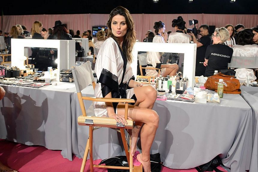 Brazilian model Isabeli Fontana posing for pictures backstage ahead of the 2014 Victoria's Secret Fashion Show at Earl's Court Exhibition Centre in London on Dec 2, 2014. -- PHOTO: AFP