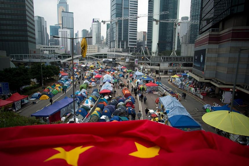 A folded Chinese flag is seen at the pro-democracy movement's main protest site in the Admiralty district of Hong Kong on Dec 2, 2014. British MPs urged the government to take a tougher line with China in an emergency House of Commons debate on Tuesd