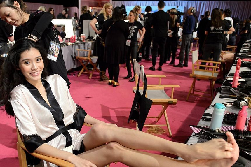 Chinese model Ming Xi backstage ahead of the 2014 Victoria's Secret Fashion Show at Earl's Court Exhibition Centre in London on Dec 2, 2014. -- PHOTO: AFP