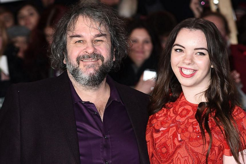 New Zealand director Peter Jackson poses for pictures on the red carpet with daughter Katie upon arrival for the world premier of The Hobbit: The Battle Of The Five Armies in central London on Dec 1, 2014. New films based on the works of J.R.R. Tolki