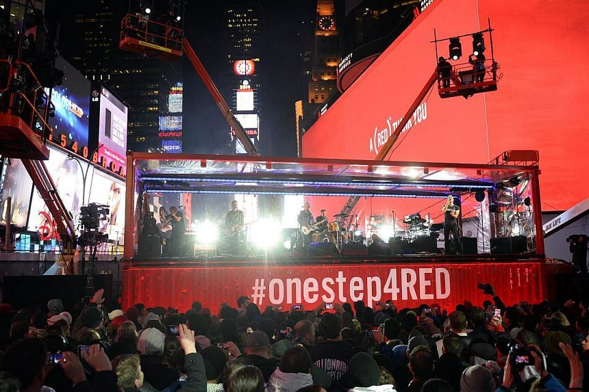 The Edge, Larry Mullen Jr. of U2 and Coldplay's Chris Martin perform during the World AIDS Day (RED) concert in Times Square in New York on Monday. The US is considering easing a ban on blood donations by gays that was established in 1983