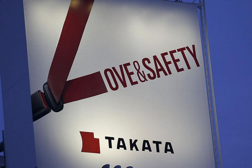 A billboard advertisement of Takata Corp is pictured in Tokyo. -- PHOTO: REUTERS