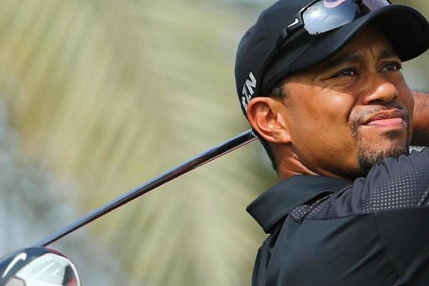 American golf superstarTiger Woods tees a shot during the 2014 Omega Dubai Desert Classic on Jan 31, 2014 in Dubai, before a back injury sidelined him several months later. He returns to competition on Thursday. -- PHOTO: AFP