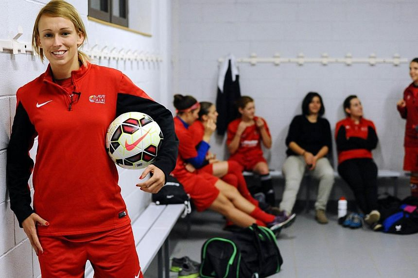 Irish forward Stephanie Roche poses in the locker room of her French Ligue 1 football club Albi in the southern commune of Albi on Nov 24, 2014.A goal scored by a Roche is creating a buzz on the Internet - because it has been short-listed