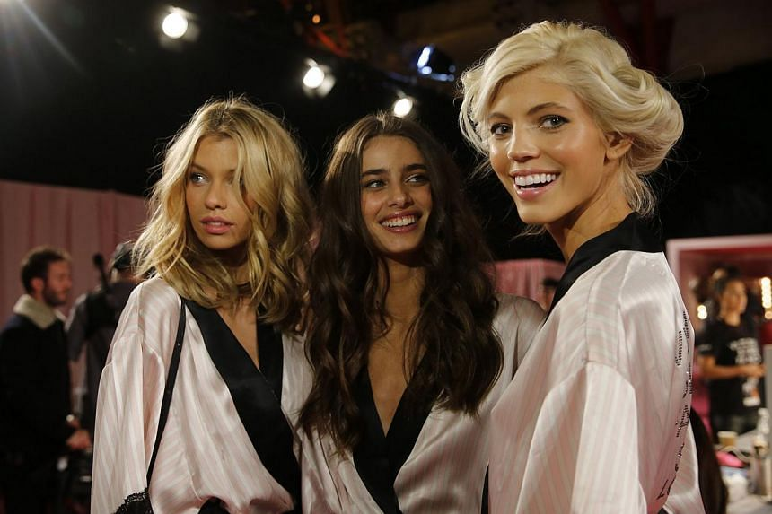 Models backstage as they prepare ahead of the 2014 Victoria's Secret Fashion Show in London on Dec 2, 2014. -- PHOTO: REUTERS