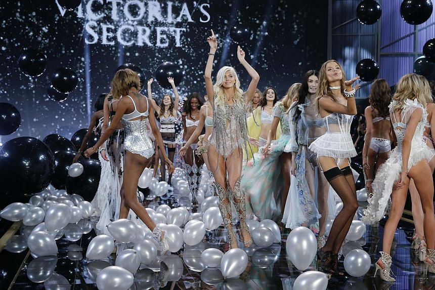 Models parading lingerie creations during the 2014 Victoria's Secret Fashion Show in London on Dec 2, 2014. -- PHOTO: REUTERS