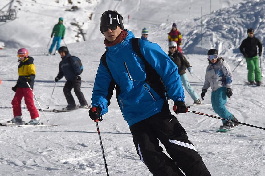 People ski down a slope at the Val Thorens ski resort in the French Alps on Nov 22, 2014, during the ski station's opening weekend. Skiers and snowboarders beware: several resorts in the French Alps, Pyrenees and Jura said Tuesday they would open at