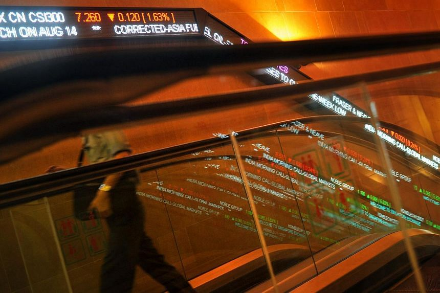 "Stock tickers along the wall at the Singapore Exchange (SGX). The software error that delayed the opening on Wednesday of the local stock market was caused by ""programming changes performed over the weekend,"" SGX says. -- PHOTO: ST FILE"