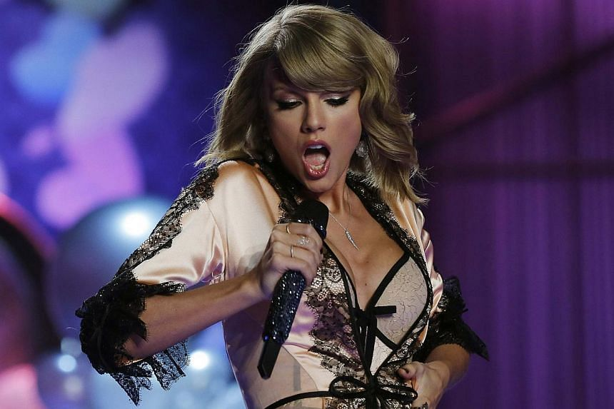 Singer Taylor Swift performing at the 2014 Victoria's Secret Fashion Show in London on Dec 2, 2014. -- PHOTO: REUTERS