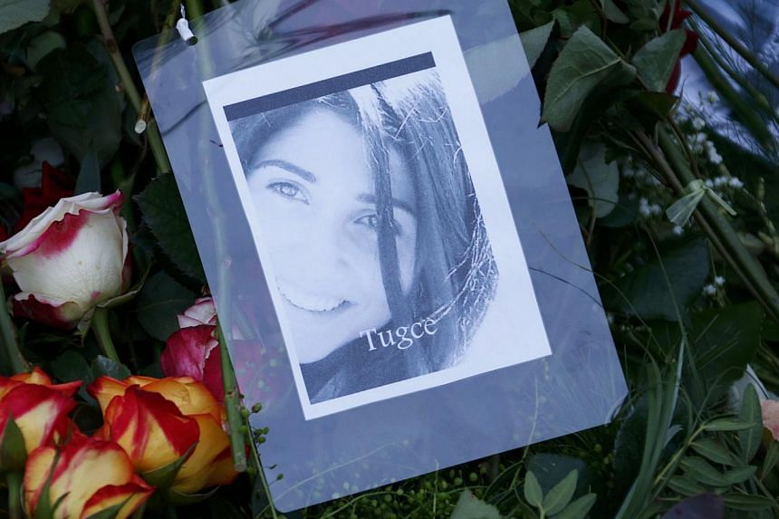 A photograph of Tugce Albayrak is placed among flowers on her grave at a cemetery in Bad Soden-Salmuenster, Dec 3, 2014. Germans flocked to the funeral on Wednesday of a young woman of Turkish origin who has become a symbol of civic courage for givin