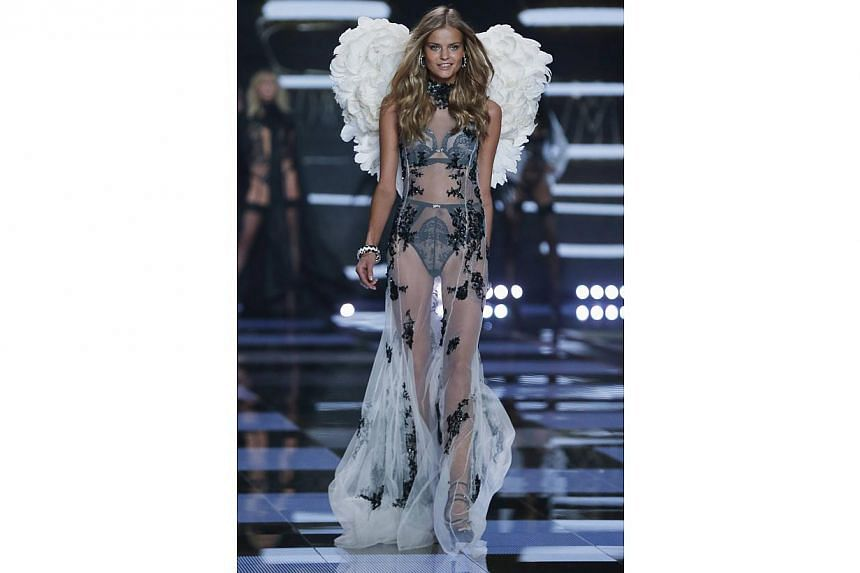 Russian model Kate Grigorieva presenting a creation at the 2014 Victoria's Secret Fashion Show in London on Dec 2, 2014. -- PHOTO: REUTERS
