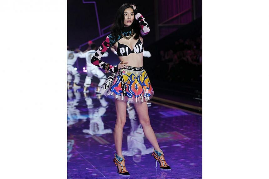 Model Ming Xi  at the 2014 Victoria's Secret Fashion Show in London on Dec 2, 2014. -- PHOTO: REUTERS