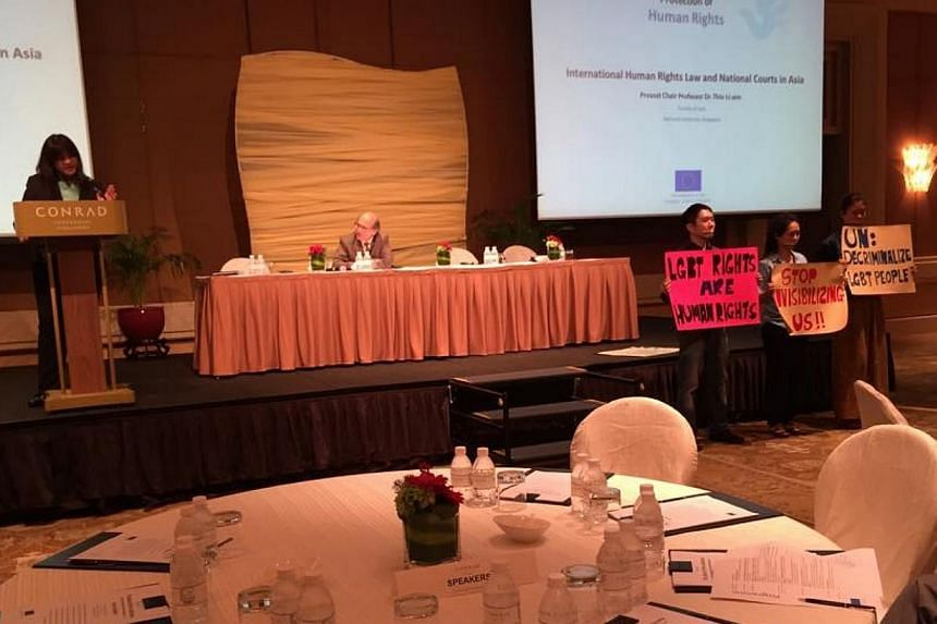 Civil society activists staged a colourful silent protest on Thursday during law professor and former Nominated Member of Parliament Thio Li-ann's speech at a human rights seminar. -- PHOTO: KIRSTEN HAN