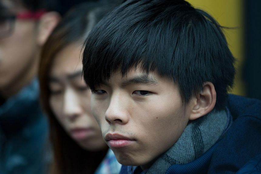 Leader of student group Scholarism, Joshua Wong attends a press conference at the pro-democracy movement's main protest site in the Admiralty district of Hong Kong on Dec 4, 2014.Hong Kong's student leaders said Thursday they would decide in th