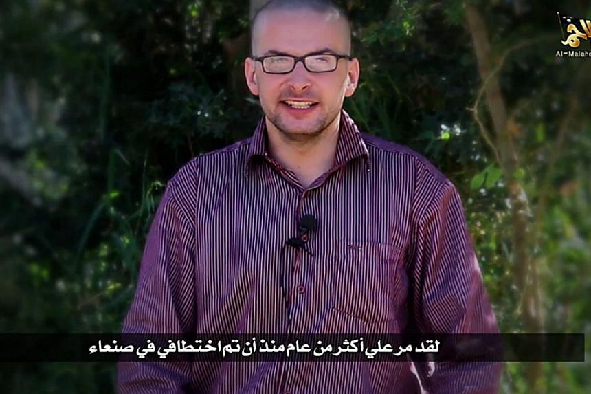A video grab taken from a propaganda video released by al-Malahem Media on Dec 4, 2014 purportedly shows US hostage Luke Somers, 33, kidnapped more than a year ago in the Yemeni capital Sanaa, calling for help and saying that his life is in danger.&n
