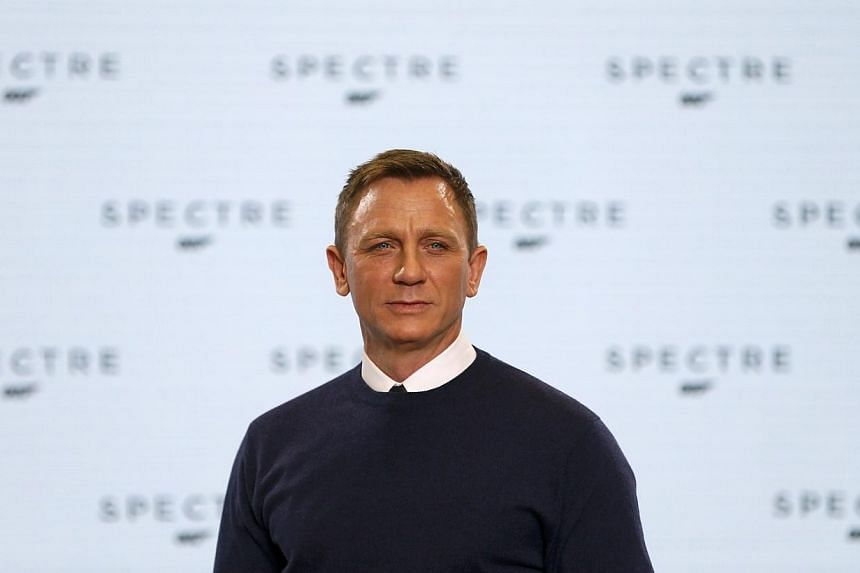 Actor Daniel Craig poses on stage during an event to mark the start of production for the new James Bond film Spectre, at Pinewood Studios in Iver Heath, southern Englandon Dec 4, 2014. -- PHOTO: REUTERS