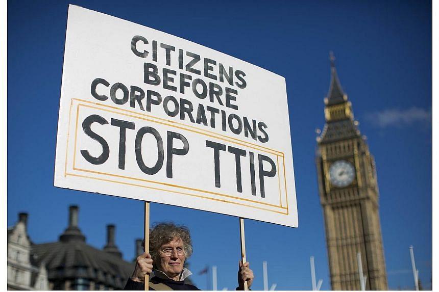 A woman demonstrates in central London on Oct 11, 2014, against the proposed Transatlantic Trade and Investment Partnership (TTIP).Opponents to a controversial trade pact between the EU and the United States passed a key threshold on Thursday s