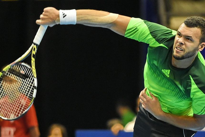 France's Jo-Wilfreid Tsonga of the Manila Mavericks play against France's Gael Monfils of the Indian Aces during their men's singles at the International Premier Tennis League (IPTL) competition in Singapore on Dec 4, 2014.-- PHOTO: AFP