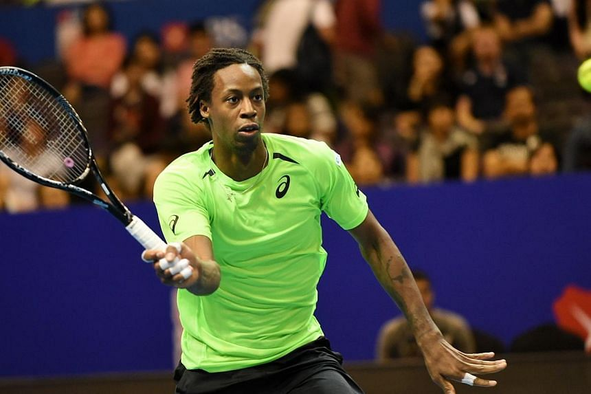 France's Gael Monfils of the Indian Aces play against France's Jo-Wilfreid Tsonga of the Manila Mavericks during their men's singles at the International Premier Tennis League (IPTL) competition in Singapore on Dec 4, 2014. -- PHOTO: AFP