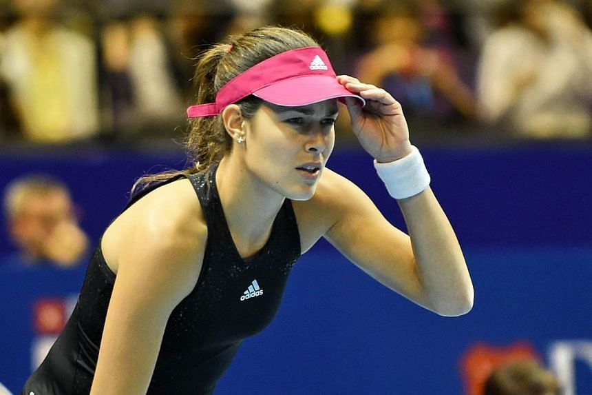 Serbia's Ana Ivanovic of India Aces looks out from a shot against Belgium's Kirsten Flipkens of the Manila Mavericks during their women's singles at the International Premier Tennis League (IPTL) competition in Singapore on Dec 4, 2014. -- PHOTO: AFP