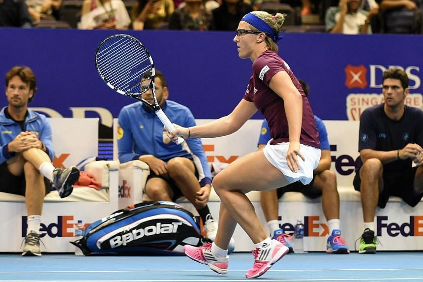 Belgium's Kirsten Flipkens of the Manila Mavericks plays against Serbia's Ana Ivanovic of India Aces during their women's singles at the International Premier Tennis League (IPTL) competition in Singapore on Dec 4, 2014. -- PHOTO: AFP