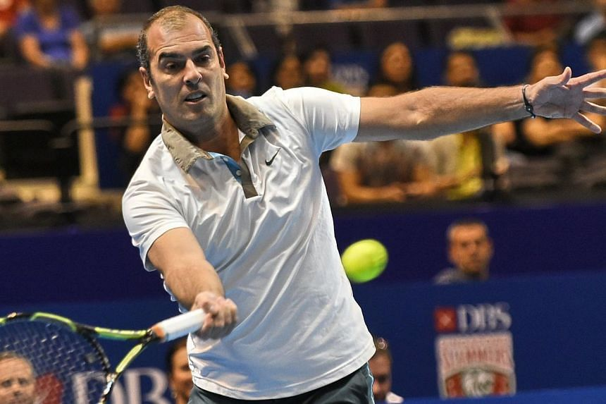 France's Cedric Pioline of India Aces plays against Australia's Mark Philippoussis of the Manila Mavericks during their men's singles at the International Premier Tennis League (IPTL) competition in Singapore on Dec 4, 2014. -- PHOTO: AFP