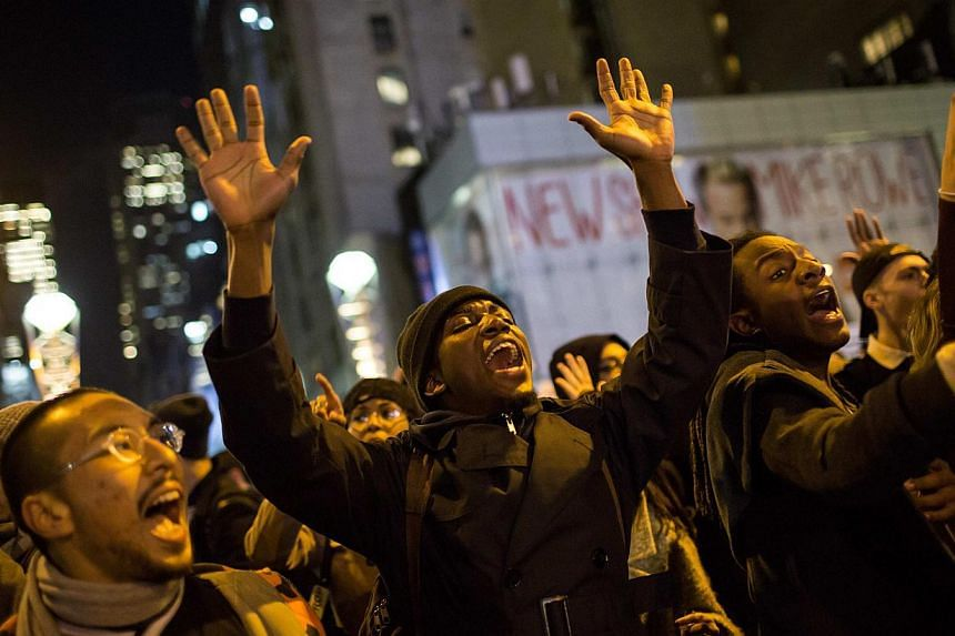 People take part in a protest against the grand jury decision on the death of Eric Garner in midtown Manhattan in New York on Dec 3, 2014. -- PHOTO: REUTERS
